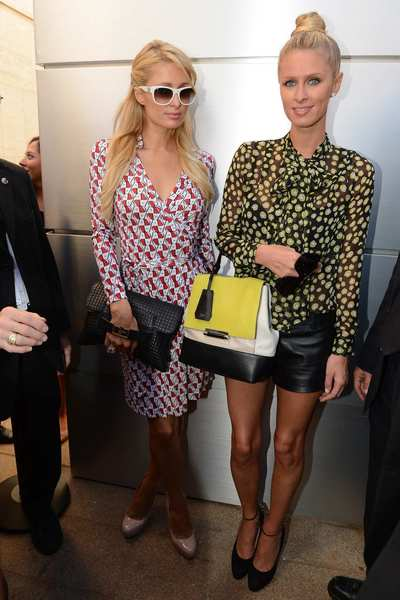 Paris Hilton (L) and Nicky Hilton are seen around Lincoln Center during Spring 2013 Mercedes-Benz Fashion Week.