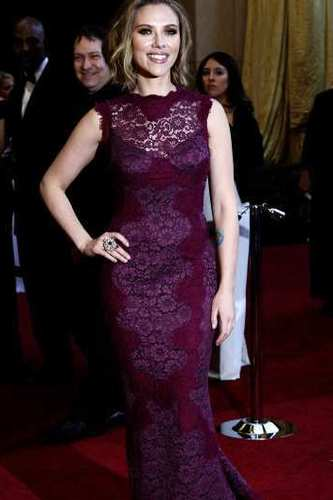 Scarlett Johansson arrives at the 2011 Oscar ceremony.