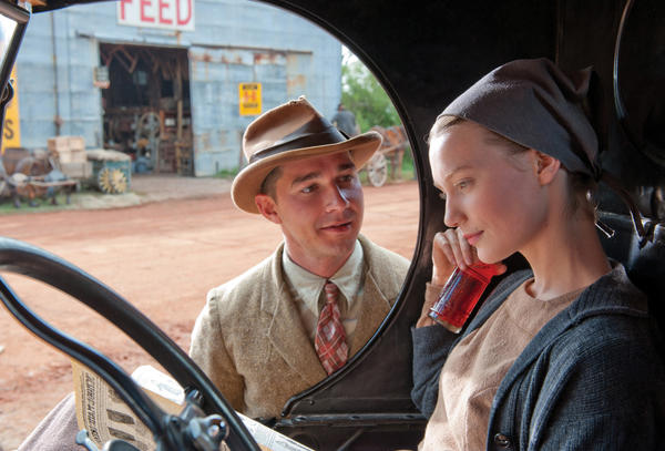 "This film image released by The Weinstein Company shows Shia LaBeouf, left, and Mia Wasikowska in a scene from ""Lawless."""