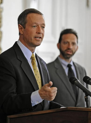 Malcolm Woolf, in background at right, with Gov. Martin O'Malley