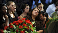 Hundreds pack church to say farewell to slain mother