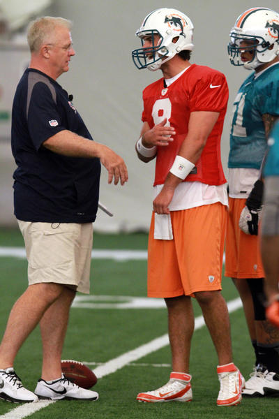 Quarterback Matt Moore (8) and Offensive Coordinator Mike Sherman talk on during the first day of practice at Miami Dolphins Training Camp in Davie