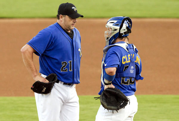 Roger Clemens talks to his son, Koby, who was his catcher during his latest outing with the Sugar Land Skeeters.