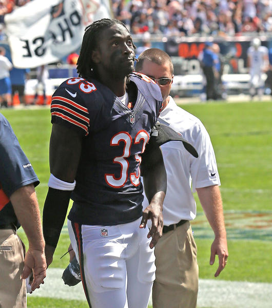 Charles Tillman leaves the field after being injured Sunday against the Colts.