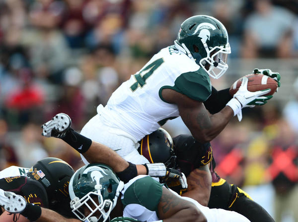 Michigan State's Le'Veon Bell goes over the top against Central Michigan.
