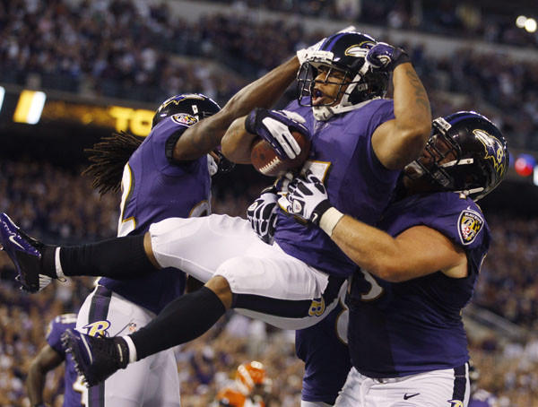Baltimore Ravens running back Ray Rice is lifted up by teammate in end zone against the Cincinnati Bengals during their NFL football game in Baltimore. (Reuters)