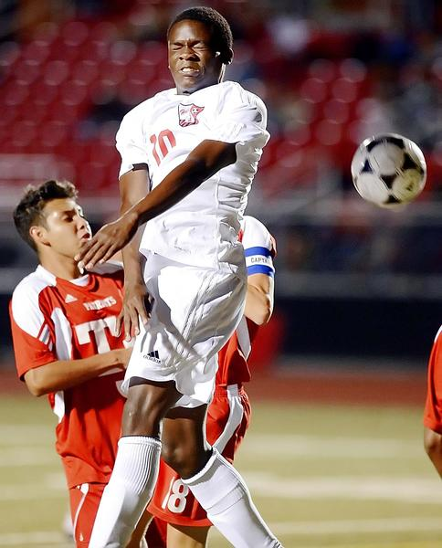 North Hagerstown's Wesley Wilson heads a shot on goal against Thomas Johnson on Monday evening.