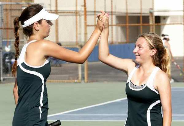 Westridge Tigers' doubles team of Amanda Mathiessen and Cameron Marsh congratulate each other after defeating their opponents from Flintridge Sacred Heart Academy.