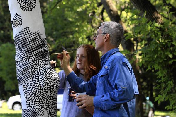 Research intern Sara Dreiser, left, and Ed Gilman, a University of Florida environmental horticulture professor, paint dots on a tree Monday at Morton Arboretum, creating targets for a stereo digital imaging system developed by NASA.