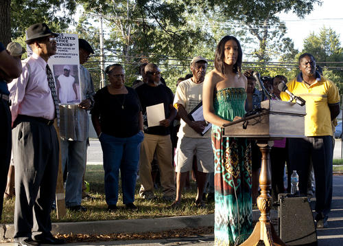 Aarika Scott, of Laurel, addresses crowd during a demonstration by the NAACP before a Laurel City Council meeting on Monday. Scott alleged that she was mistreated by police officers after a traffic stop for expired tags in July, and that she was held for two days without being allowed to make a phone call.