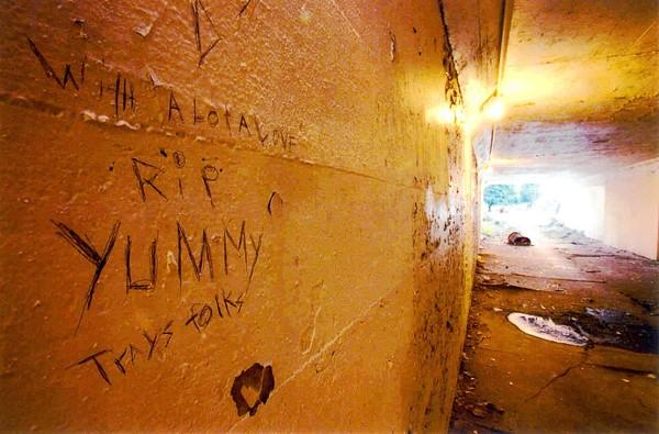 "A graffiti memorial marks a wall in the South Side viaduct where Robert ""Yummy"" Sandifer's body was found."