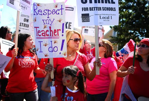 "Teachers from Peck Elementary protest outside Marantha Assembly of God, a ""safe haven"" site visited Monday by Mayor Rahm Emanuel."