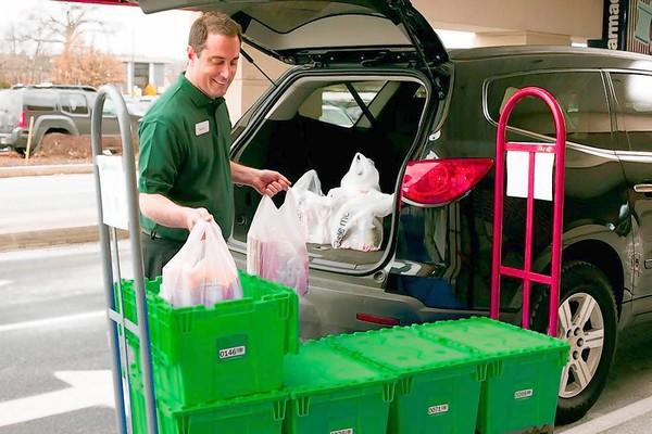 In this handout photo, a Peapod worker loads groceries into an automobile. Peapod will open three locations in the Chicago area this year where customers can pick up their orders rather than waiting for home delivery.