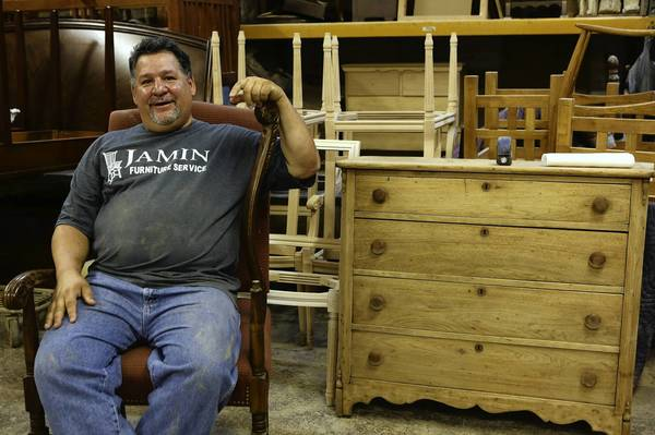 Jamin Ortiz, 51, owner of Jamin Furniture Service in Chicago, says business is good. And if it stays that way, he wants to buy the shop he rents.