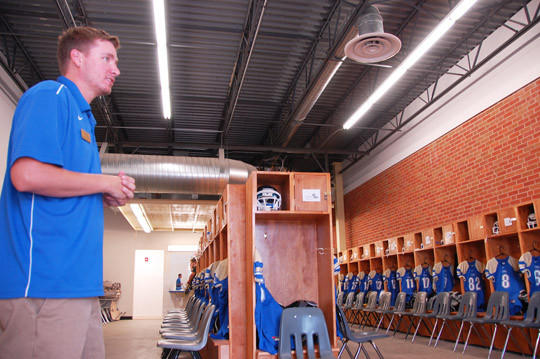 Colby Simonsen, sports information director at Trinity Bible College, gives a tour of one of the new fitness center's locker rooms. The project cost, from the new building to the remodel of the gym, roughly $1 million and was completely funded through private donations.