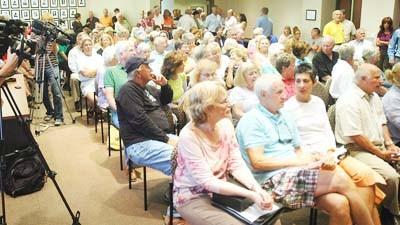 Community members pack the Charlevoix City Council chambers Sept. 4, many of them to voice opposition to a community fireplace project in the city East Park.