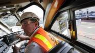 Metrolink on Monday previewed a pioneering, $200-million crash prevention project for a top federal safety official, who expressed concern about railroad industry efforts to postpone deadlines for installing the sophisticated train safety system in other parts of the country.