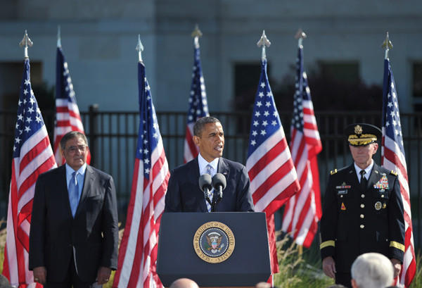 President Obama speaks flanked by Defense Secretary Leon Panetta, left, and Chairman of the Joint Chiefs of Staff Gen. Martin Dempsey, right, during a ceremony commemorating the 11th anniversary of the 9/11 attacks on September 11, 2012 at the Pentagon in Washington, DC.