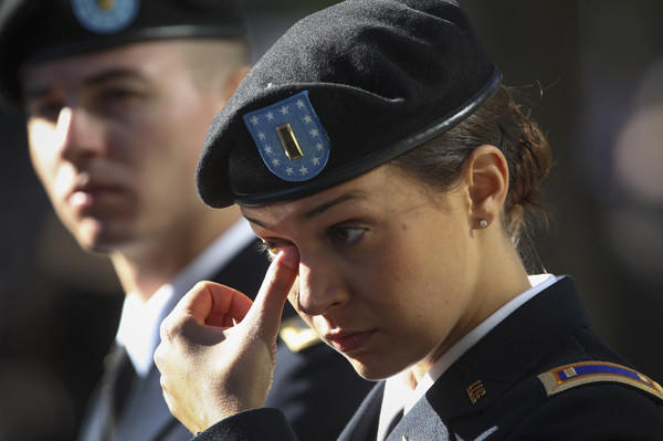 U.S. Army Second Lieutenant Mudge wipes a tear during ceremonies marking the 11th anniversary of the 9/11 attacks on the World Trade Center in New York.