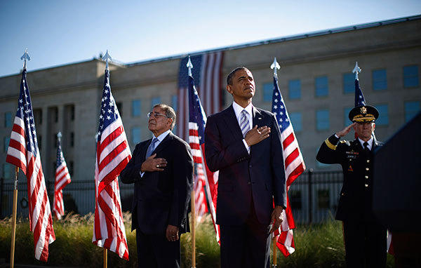 U.S. President Barack Obama (C), U.S. Secretary of Defense Leon Panetta (L) and Chairman of the Joint Chiefs of Staff Martin Dempsey attend an event commemorating the 11th anniversary of the September 11 attacks, at the site of the attack on the Pentagon near Washington, September 11, 2012.