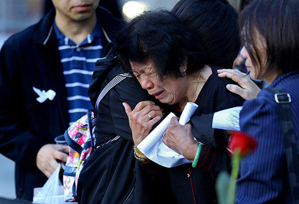 A woman cries at the 9/11 memorial during ceremonies for the eleventh anniversary of the terrorist attacks on lower Manhattan at the World Trade Center site September 11, 2012 in New York City. New York City and the nation are commemorating the eleventh anniversary of the September 11, 2001 attacks which resulted in the deaths of nearly 3,000 people after two hijacked planes crashed into the World Trade Center, one into the Pentagon in Arlington, Virginia and one crash landed in Shanksville, Pennsylvania.