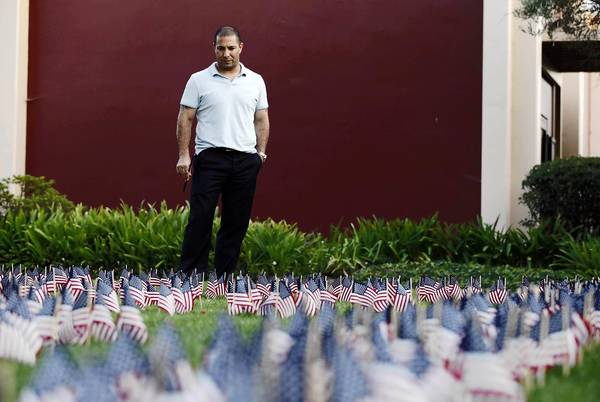 Ivan Krimker, a veteran Navy corpsman who served in a Marine Corp infantry during two tours in Iraq from 2004-2008, looks out over an installation of hundreds of American flags at Whittier Law School, to pay tribute to the tragedy of September 11, 2001. Krimker, who is a member of the Whittier Veteran Law Student Association designed the tribute and lead a group of students with the student body association in installing the temporary tribute.