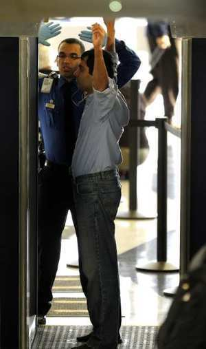 An airline passenger proceeds through a full-body scanner this week at Chicago's O'Hare Airport.