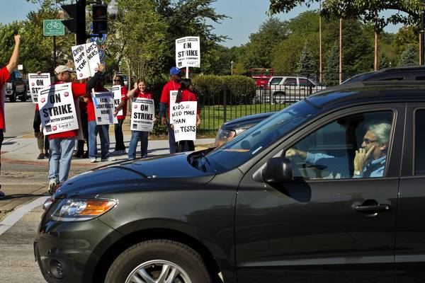 Chicago Public Schools teachers walk a picket line near Dunbar Vocational Career Academy in Chicago.