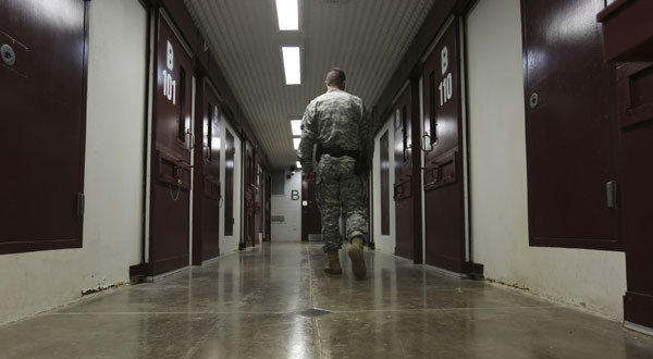 An Army guard walks the hallway in Camp 5 at U.S. Navy base at Guantanamo Bay, Cuba.