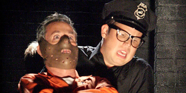 "Davis Gaines as Hannibal Lecter, front, and Jeff Hiller as Guard in a scene from the play, ""Silence! The Musical."""