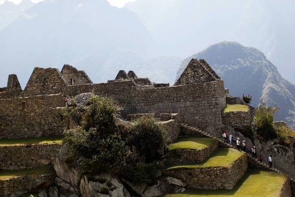 Tourists visit the Inca citadel of Machu Picchu in Cuzco August 21, 2012. Machu Picchu is Peru's top tourist attraction, drawing some 2,500 visitors a day, according to local authorities.