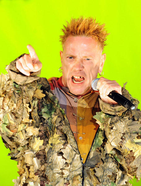 Sex Pistols singer Johnny Rotten lives up to his name by wearing a jacket that appears as though he has rolled around in super glue and rotten leaves. He turns 54 today.