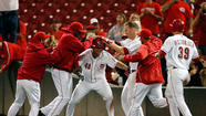 Reds win in 14 innings