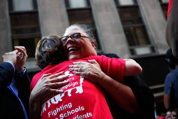 Chicago Teachers Union president Karen Lewis, right, hugs Randi Weingarten, president of the American Federation of Teachers during a rally in Chicago on the second day of the Chicago teachers strike.