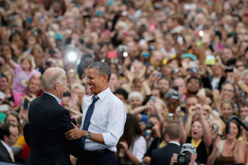 Vice President Joe Biden welcomes President Obama to the stage during a campaign rally at the University of Iowa in Iowa City, Iowa.