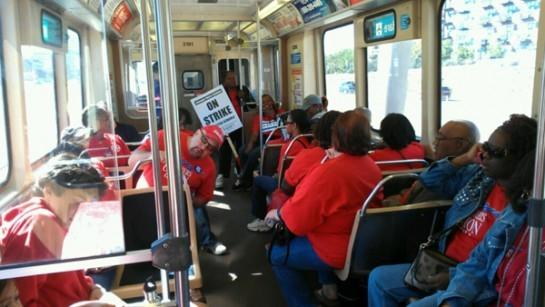 "Teachers and supporters head downtown on the ""L"" for a rally and march. MASH PHOTO/CHRIS PIEPER"