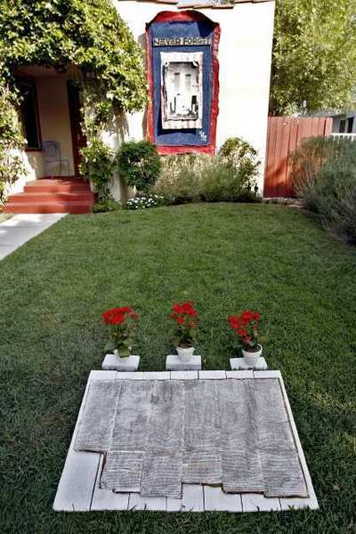 The front yard display commemorating the 9/11 attacks at Jimmy Arone's house.