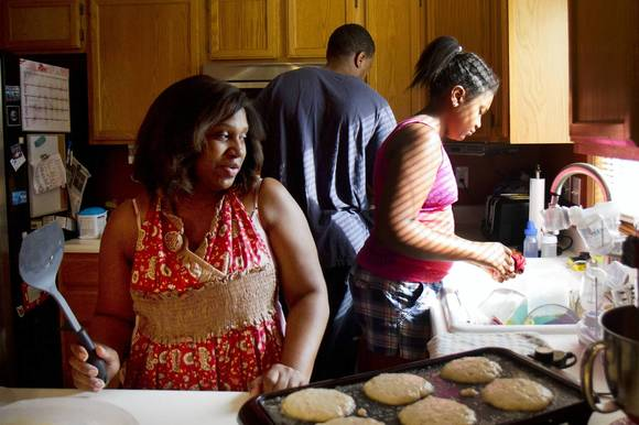 "Joyce Cunningham of Schererville, Ind., prepares banana nut pancakes for a Sunday breakfast as her husband Shamiyah and daughter Hannah help in the kitchen. Cunningham says she followed advice from ""the older, wiser women"" in her life as she made dietary decisions for her six children."
