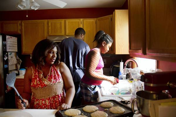 "Joyce Cunningham of Schererville, Ind., prepares banana nut pancakes for a Sunday morning breakfast as her husband Shamiyah and daughter Hannah help in the kitchen. Cunningham says she followed advice from ""the older, wiser women"" in her life as she began to make dietary decisions for her six children, who range in age from 20 years to two months."