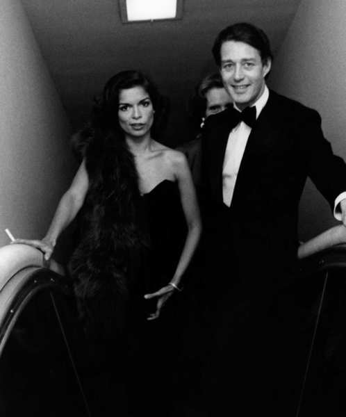 "Halston and Bianca Jagger attend the exhibit ""The Glory of Russian Costume"" at the Metropolitan Museum of Art in New York on Dec. 6, 1976."