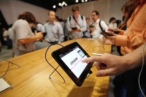 Journalists try out Amazon.com's Kindle Fire HD during its unveiling at an event in Santa Monica.