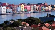 CURACAO — The Jones family never likes a vacation to come to an end, especially when work has squeezed it to a mere five days. So, unsurprisingly, we arrived at the very last minute at Halo International Airport in Curacao for our sadly premature flight home. Returning our car, filled with sand and shells imported by two beach-happy kids, had required lengthy, fee-avoiding apologies to a frowning Budget agent.