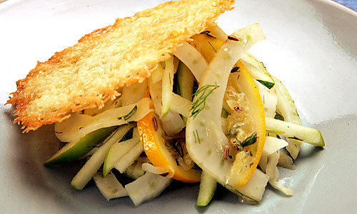 "Top a fennel-apple slaw with a pretty frico (cracker-like baked Parmigiano-Reggiano), the salt and crunch of the cheese a perfect contrast with the pale, cool reprieve of the salad.  <a href=""http://www.latimes.com/features/la-fo-cheeserec28c-2009jan28,0,5153210.story"">Click here for the recipe.</a>"