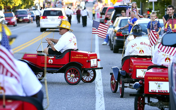 Members of the Hagerstown Ali Ghan Shriners ride take part in the annual Remembrance Parade in Boonsboro Tuesday in honor of the fire, rescue and law enforement personnel who lost their lives on Sept. 11, 2001.