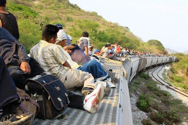 Migrants travel through Mexico's Veracruz state atop a train. The disappearances of Central Americans headed to the U.S. went largely unnoticed until August 2010, when 72 migrants from El Salvador, Honduras and Guatemala were abducted and slain, execution-style, in the northeastern Mexico state of Tamaulipas, allegedly by gunmen from the Zetas gang.