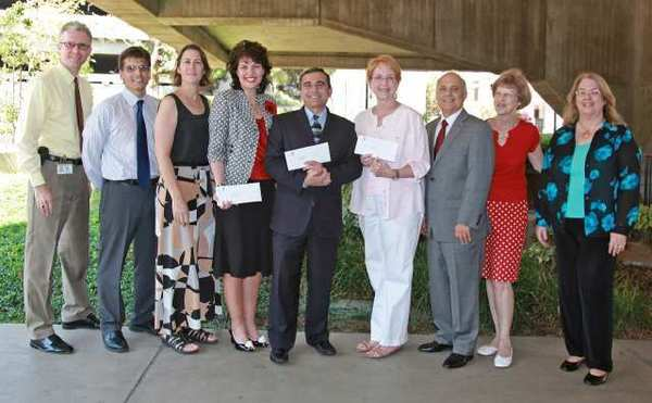 Celebrating the Glendale City Employees Endowment Fund grant distribution are, from left, city employees Matt Doyle andÊAlex Souto;ÊCity Council memberÊLaura Friedman;ÊSandy Doughty, GAR Services;ÊGeorge Saikali, Glendale YMCA; Laurel Patric, Glendale Educational Foundation; Mayor Frank Quintero; and city employees Jane Karageorge and Debbie Mallon.