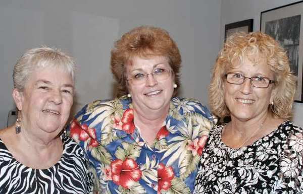Among Betsy Luekes former co-workers and family members in attendance for Fridays opening reception were, from left, Carol Finkle, Mary Jo Watkins and Linda Oseransky.