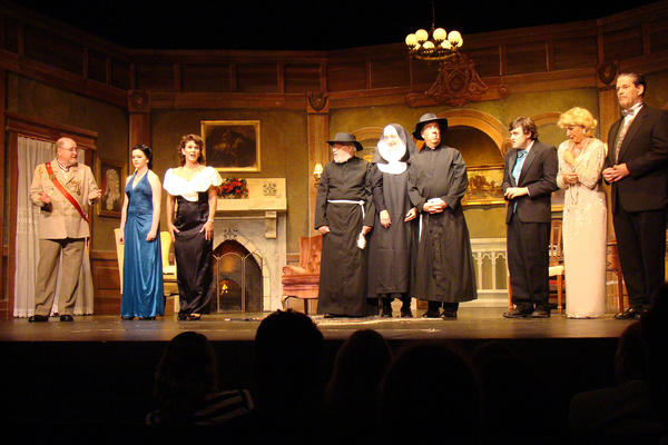 """From left, Major Quimby (played by Gene Valendo), Emma Reese (Vivian Wingard), Jane (Rosalie Daelemans), Priest (Marty Hayes), Nun (Heidi Toll), Priest (Joe Biddle), Charles Pomeroy (Zak Zeeks), Lady Somerset (Heather Tuckfield) and Devon Tremaine (Tim Sayles) participate in a scene from 2nd Star Productions' """"Bloody Murder."""""""