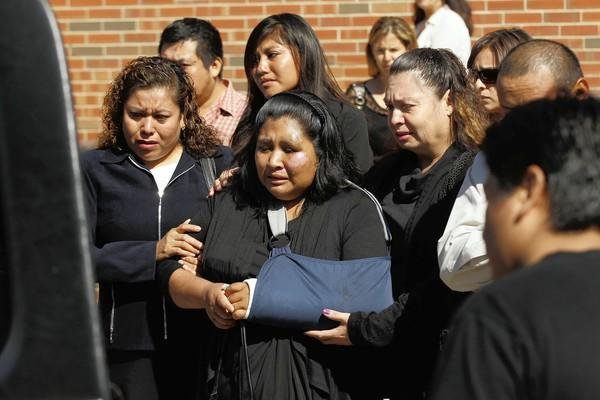>Her arm in a sling, Modesta Sacramento Jimenez is comforted Tuesday during the funeral of her 5-year-old daughter, Jaclyn Santos-Sacramento, who was killed Sept. 3 when police say Jaclyn, her mother and two brothers