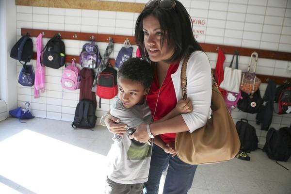 Ethan White, 7, surveys a room full of unfamiliar children at the Sheridan Park field house, 901 S. Aberdeen St. His mother, Elvia Bravo-White, brought him there for a Play in the Park day, designed to help parents while the kids are missing school during the strike.